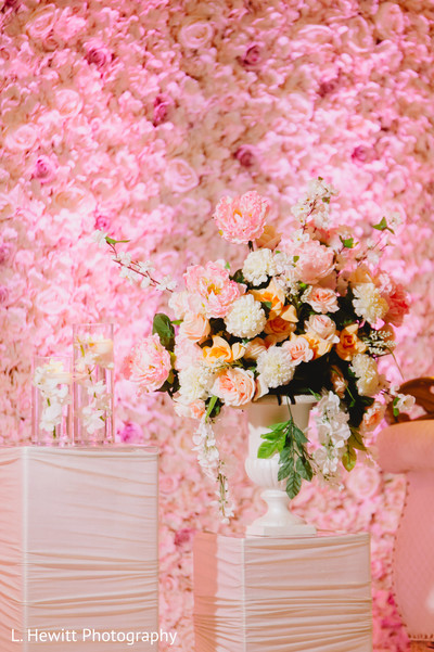 Indian wedding reception stage peach and pink flowers decorations,