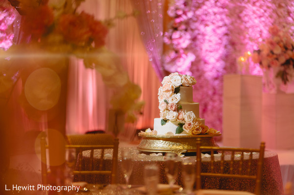 Indian ivory and peach wedding reception cake.
