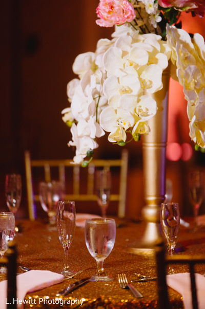 Indian wedding white orchid table centerpiece decoration.