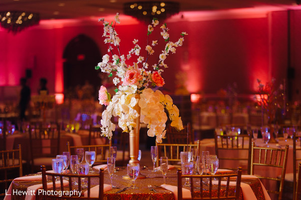 Indian wedding reception table tall flower vase decor.
