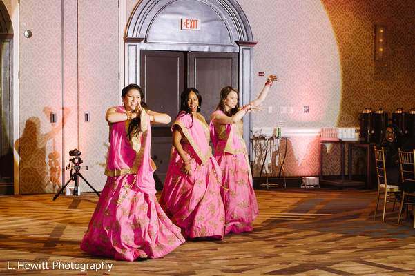 Indian bridesmaids dancing entrance to reception party.