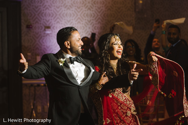 Indian couple making their entrance to wedding reception.
