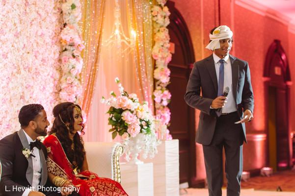Indian groomsmen at reception speech capture.