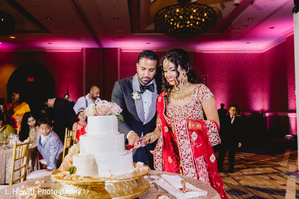 Indian couple cutting the cake capture.