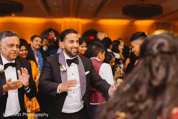 Indian groom at reception dance photography.