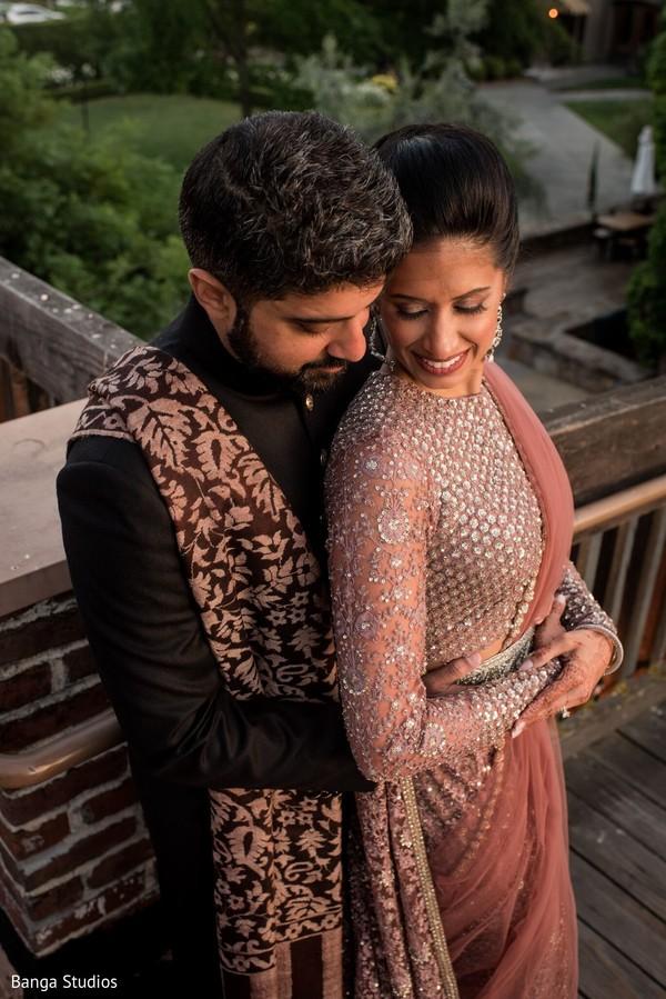 Raja hugging maharani at reception photo session.