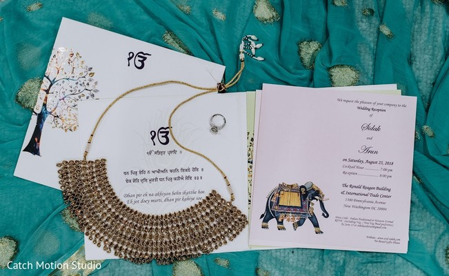 Indian bridal Golden Kundan necklace and invitations capture.