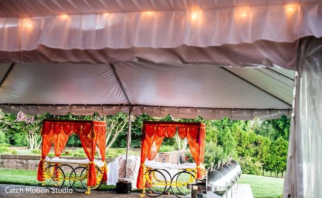 Orange draping decorating indian wedding wagons.