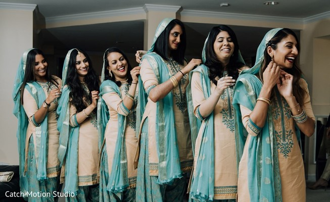Indian bridesmaids on their light blue and ivory punjabi dresses.
