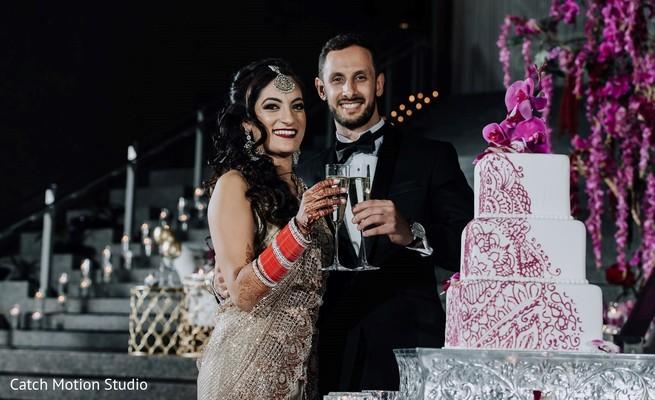 Indian bride and groom having cheers.