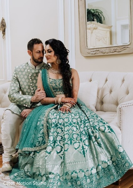 Indian couple on their pre-wedding outfits for sangeet.