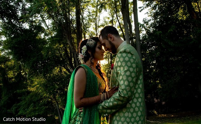 Indian couple on their traditional Indian sangeet fashion.