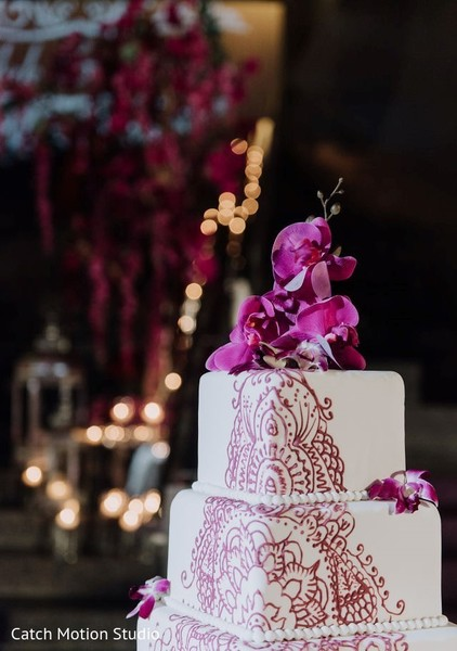 white and magenta indian wedding cake decoration.