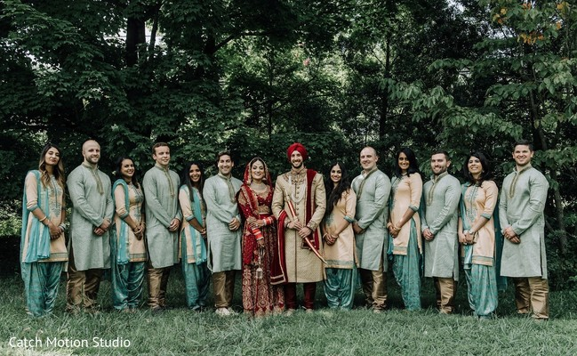 Indian couple with bridesmaids and groomsmen outdoors capture.