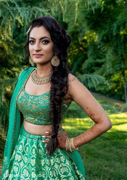 Green and golden maharani's sangeet lehenga.