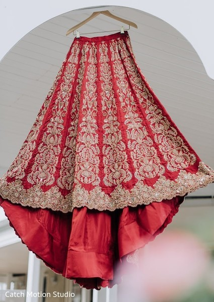 Indian bridal red and golden lehenga.