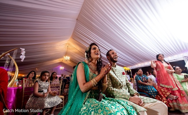Indian bride and groom at sangeet party capture.