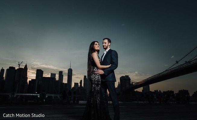 Indian couple posing outdoor on gala suits for photo session