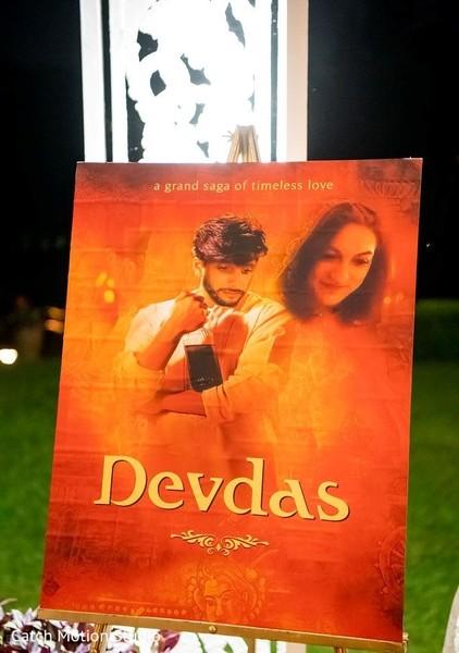 Devdas Indian wedding orange sign decor.