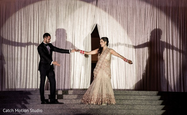 Indian couple's wedding reception dance.