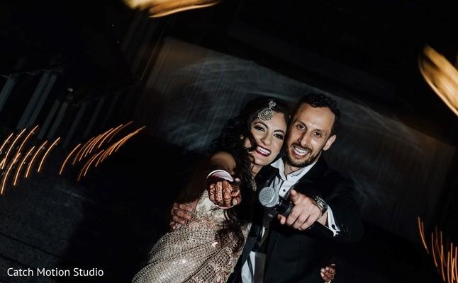 Joyful Indian couple at reception speech capture.