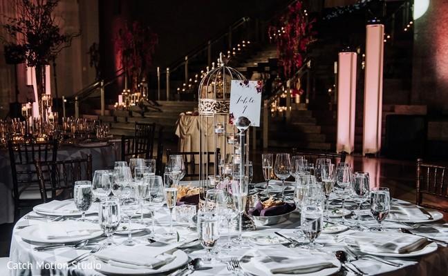Indian wedding reception round table setup.