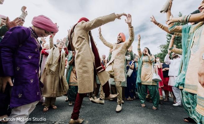 Indian groom dancing at baraat procession.