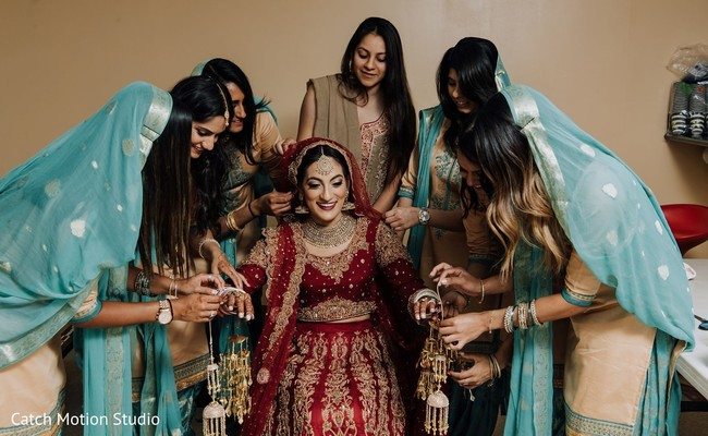 Indian bride getting her Kalire for ceremony on.