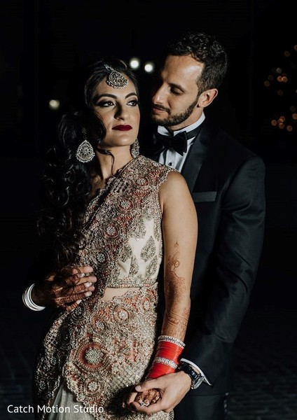 Indian bride with groom with their reception saree and suit.
