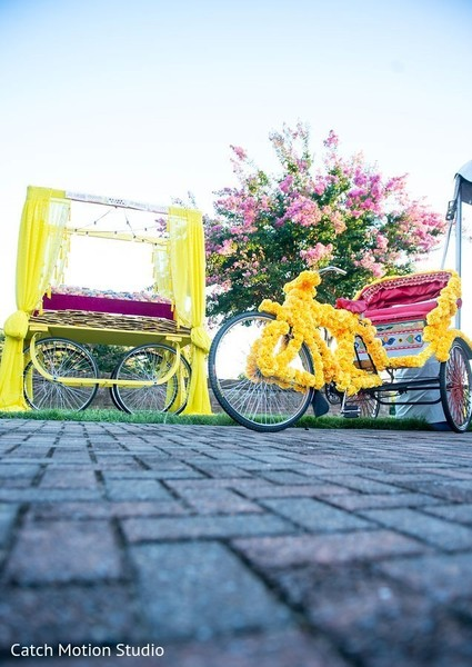 Sangeet tricycle and wagon with favors decorations.