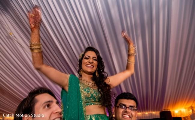 Maharani lifted by groomsmen.