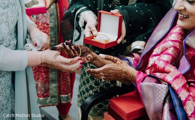 Maharani getting her wedding gold bangles on.