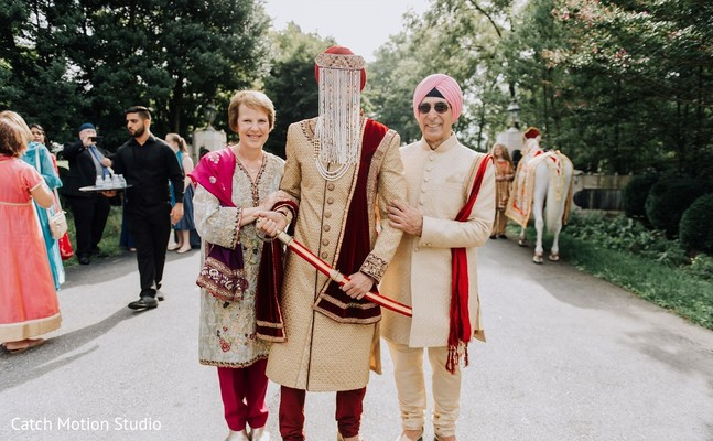Indian groom and relatives on their wedding outfits.