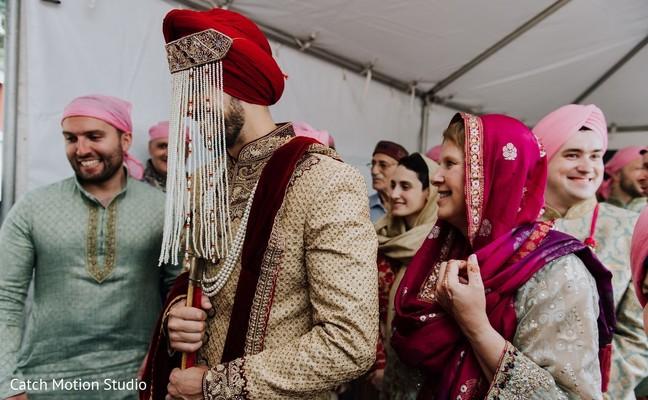Indian groom wearing his sehra.