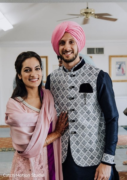 Indian couple on their blue and pink pre-wedding outfits.