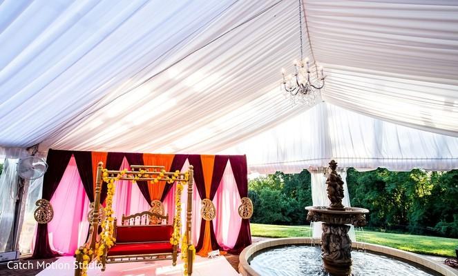 Burgundy orange, pink and white draping sangeet decor.