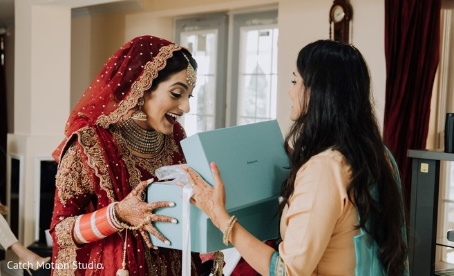 Maharani getting a present while getting ready.