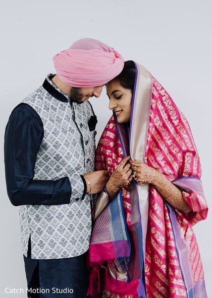 Sweet Indian couple posing on pre-wedding outfits.