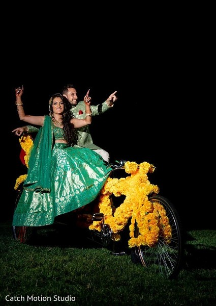 Indian couple on Sangeet tricycle decoration.
