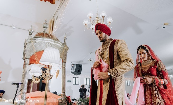Indian bride and groom at the jaimala ritual.