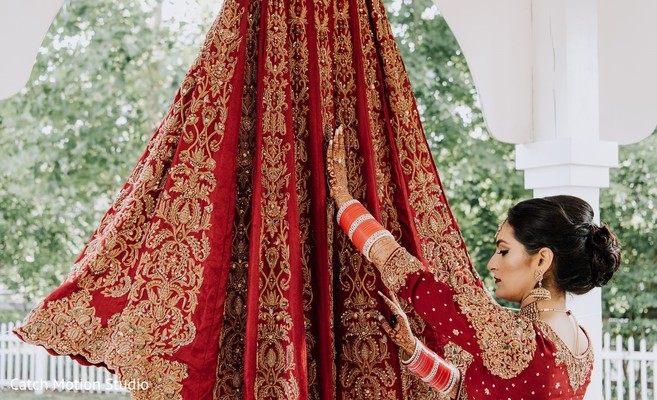 Indian bride getting her wedding ceremony skirt on.