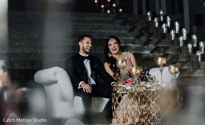 Indian couple at their reception table.