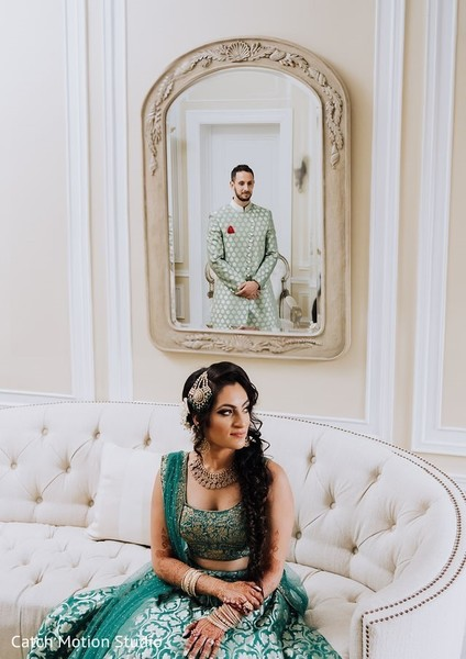 Elegant indian bride and groom on Sangeet outfits.