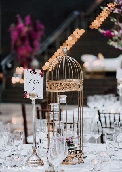 Indian wedding table cage centerpiece decor.