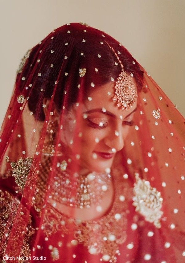 Indian bridal ceremony red with golden dots veil.
