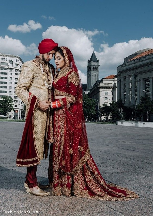 Indian couple holding hands first look photography.