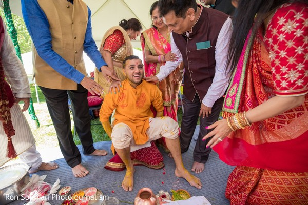 Indian groom smiling at the end of the Gaye Holud