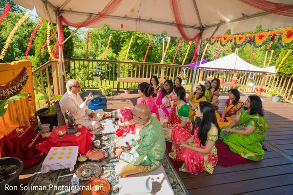 Indian bride and Indian relatives hearing an Hindu priest