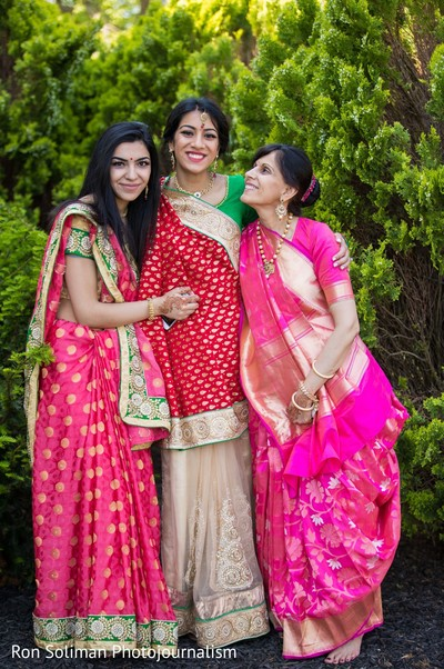 Indian bride posing with two of her Indian relatives