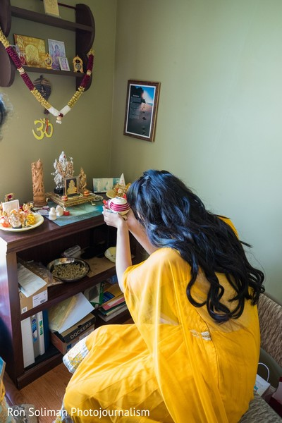 Indian bride making an offering to Ganesha, god of beginnings